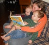 Aunt Anna reads to Milan and Alek